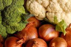Vegetable medley. Broccoli, cauliflower and shallots on a wooden table Royalty Free Stock Photo