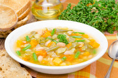 Vegetable minestrone with white beans and toast horizontal Royalty Free Stock Image