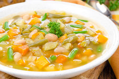 Vegetable minestrone with white beans and toast horizontal Royalty Free Stock Photo