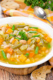Vegetable minestrone with white beans and toast vertical closeup Stock Photo