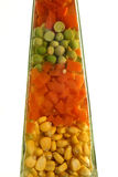 Vegetable mix. Vegetables mix various types in a decorative bottle, isolated royalty free stock images
