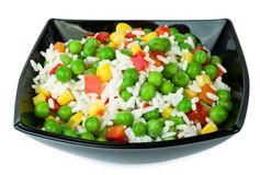 Vegetable mix in black salad bowl Stock Photos