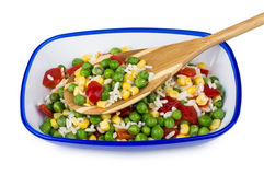 Vegetable mix in blue bowl and bamboo spoon Royalty Free Stock Images