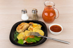 Vegetable mix  with cutlet in plate, salt, pepper, tomato juice Stock Photos