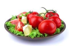 Vegetable mix on dark dish. Over white background stock photos