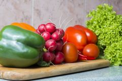 Vegetable mix on the kitchen board. Vegetarian food royalty free stock photography