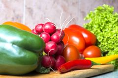 Vegetable mix on the kitchen board. Vegetarian food stock photography