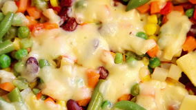 Vegetable mix with molten cheese stock video