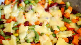 Vegetable mix with molten cheese stock footage
