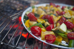 Vegetable mix prepared on a grill. With fire in a background Stock Image