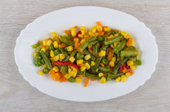 Vegetable mix in white oval dish on table Stock Images