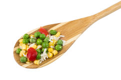 Vegetable mix in wooden bamboo spoon isolated on white Royalty Free Stock Photos