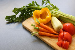 Vegetable mix on wooden board with copy space Royalty Free Stock Photo