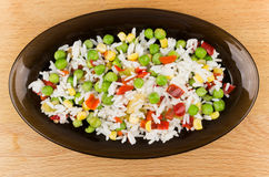Vegetable mixture in dish on wooden tabl Royalty Free Stock Photo