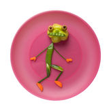 Vegetable monster on pink plate Royalty Free Stock Photography