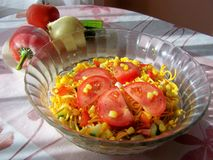 Vegetable noodle salad close up. The sunlight is shinning on the freshly made salad stock photography