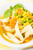 Vegetable and noodle soup. With green peas, carrot and corn Stock Image