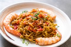 vegetable noodle with tomatoes sauce and shrimps Stock Photos