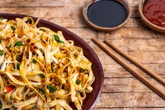 Vegetable noodles with soy sauce and ketchup. Tabletop view asian tomato chopsticks plate food wooden cooking cuisine dinner gourmet pasta pepper restaurant royalty free stock photography