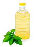 Vegetable oil in a bottle with basil Stock Photo