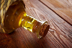 Vegetable oil bottle. Closeup on the old wooden table Royalty Free Stock Images