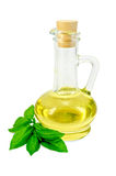 Vegetable oil in a carafe with basil Stock Images