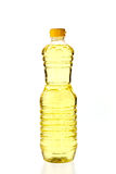 Vegetable oil for cooking in a bottle isolated on white Royalty Free Stock Photography