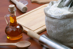 Vegetable oil and kitchen tools Royalty Free Stock Images