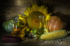 Vegetable oil. Still life with sunflowers, corn, pumpkin and vegetable oil Stock Photography
