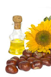 Vegetable oil, sunflower and chestnuts. Isolated on a white background Royalty Free Stock Images