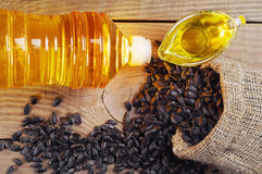 Vegetable oil and sunflower seeds Royalty Free Stock Photos
