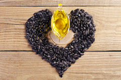 Vegetable oil and sunflower seeds Stock Photo