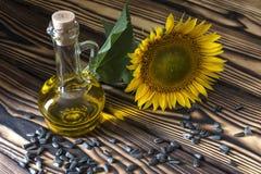 Vegetable oil. Is on the table near sunflower Stock Photos
