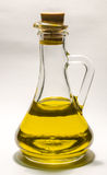 Vegetable oil in a transparent bottle decanter with stopper on a white background. Vegetable oil in a transparent bottle decanter with stopper Stock Image