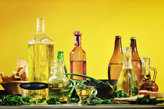 Vegetable oil on a yellow background Royalty Free Stock Photography