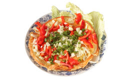 Vegetable omelet. On a plate isolated stock images