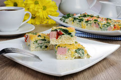 Vegetable omelet with spinach. Canape of omelet with spinach, sausage and a cup of coffee Stock Photos
