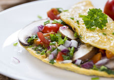 Vegetable Omelette. (close-up shot) with fresh mushrooms and herbs royalty free stock photography
