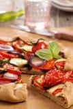 Vegetable open pie Stock Photos
