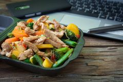 Vegetable oriental food. Oriental wok vegetables to eat at work with chicken Stock Photo