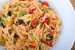 Vegetable orzo. Pasta salad on plate stock photo
