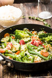 Vegetable pan with fresh ingredients and rice Royalty Free Stock Photo