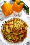 Vegetable pancakes. Vegetarian pancakes of milk, flour, eggs. Yellow paprika, courgette, leek, onions and chives added royalty free stock image