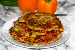 Vegetable pancakes. Vegetarian pancakes of milk, flour, eggs. Yellow paprika, courgette, leek, onions and chives added Royalty Free Stock Photo