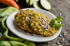 Vegetable pancakes with zucchini, carrot, chia, flax seeds and oatmeal Royalty Free Stock Photo