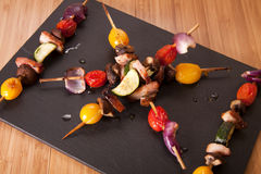 Vegetable and pancetta skewers. Stock Image