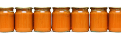 Vegetable paste in glass jars Stock Photo