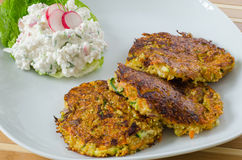 Vegetable patties with cottage cheese and radish salad Stock Images