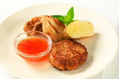 Vegetable patty with potatoes and spicy dip Royalty Free Stock Photography