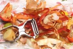 Vegetable Peels. Pile of vegetable peelings with peeler Stock Image